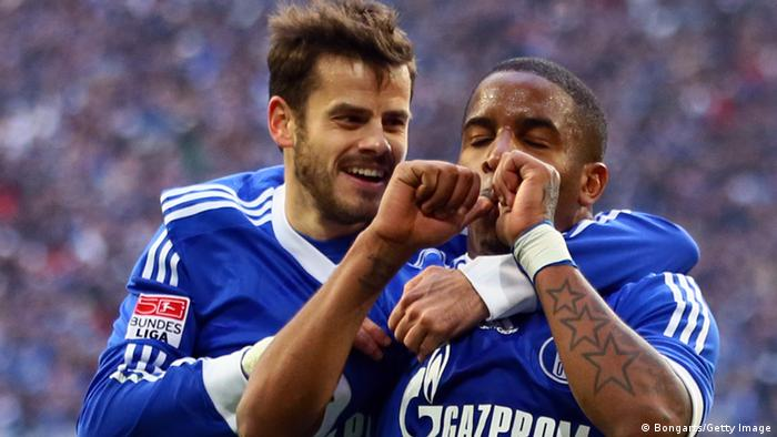 GELSENKIRCHEN, GERMANY - OCTOBER 27: Jefferson Farfan of Schalke (R) celebrates the first goal with Tranquillo Barnetta of Schalke (L) during the Bundesliga match between FC Schalke 04 and 1. FC Nuernberg at Veltins-Arena on October 27, 2012 in Gelsenkirchen, Germany. (Photo by Christof Koepsel/Bongarts/Getty Images)