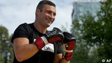 WBC Heavyweight boxing champion Vitali Klitschko of Ukraine smiles during an open training session in Moscow, Russia, Wednesday, Aug. 5, 2012. Klitschko will face Manuel Charr of Germany in Moscow on Sept. 8. (AP Photo /Alexander Zemlianichenko)