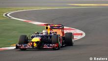 Red Bull Formula One driver Sebastian Vettel of Germany drives ahead of his team mate Mark Webber of Australia at the start of the Indian F1 Grand Prix at the Buddh International Circuit in Greater Noida, on the outskirts of New Delhi, October 28, 2012. REUTERS/Vivek Prakash (INDIA - Tags: SPORT MOTORSPORT F1)