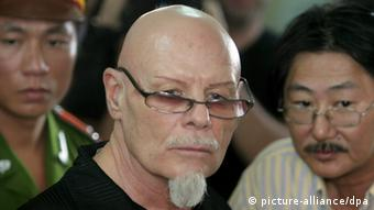 Gary Glitter listening to the verdict as he is convicted in a child molestatin case in Vietnam.