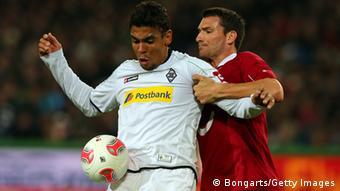 HANNOVER, GERMANY - OCTOBER 28: Mario Eggimann (R) of Hannover and Igor de Camargo (L) of Gladbach battle for the ball during the Bundesliga match between Hannover 96 and Borussia Moenchengladbach at AWD Arena on October 28, 2012 in Hannover, Germany. (Photo by Martin Rose/Bongarts/Getty Images)