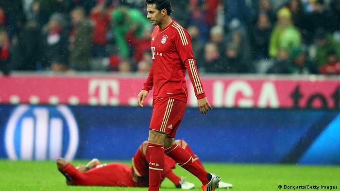 MUNICH, GERMANY - OCTOBER 27: (L-R) Jerome Boateng and Claudio Pizarro of Bayern look dejected after losing 1-2 the Bundesliga match between FC Bayern Muenchen and Bayer 04 Leverkusen at Allianz Arena on October 27, 2012 in Munich, Germany. (Photo by Christof Koepsel/Bongarts/Getty Images)