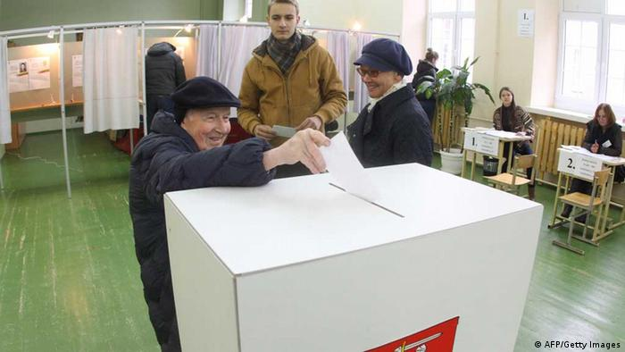 A man casts his ballot at a polling station in Vilnius, Lithuania on October 28, 2012. Lithuania's leftwing and populist opposition parties beat the Conservatives of Prime Minister Kubilius, who pushed through draconian spending cuts as the nation of three million was battered by one of the world's deepest recessions in the first round of the Baltic state's parliamentary polls. AFP PHOTO / PETRAS MALUKAS (Photo credit should read PETRAS MALUKAS/AFP/Getty Images)