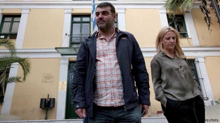 Greek editor Costas Vaxevanis (L) leaves a prosecutor's office in Athens October 28, 2012. Greek police arrested the editor of a weekly magazine for publishing a list of more than 2,000 names of wealthy Greeks who have placed money in Swiss bank accounts, police said on Saturday. The so-called Lagarde List - given to Greece by French authorities in 2010 with names to be probed for possible tax evasion - has been a topic of heated speculation in Greek media in recent weeks. It is named after International Monetary Fund chief Christine Lagarde, who was French finance minister when the list was handed over. REUTERS/Icon/Costas Baltas (GREECE - Tags: POLITICS CRIME LAW MEDIA BUSINESS)