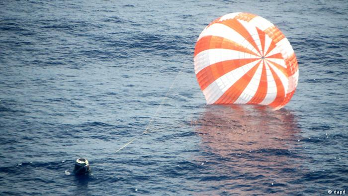 This photo provided by SpaceX shows an unmanned Dragon freighter during its splashdown, a couple hundred miles off the Baja California coast. (AP Photo/SpaceX)