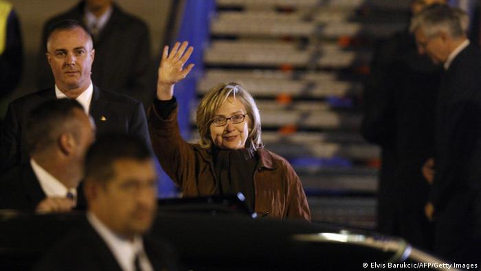 US Secretary of State, Hillary Clinton waves as she walks out of airplane, upon arrival at Sarajevo airport. (Photo: ELVIS BARUKCIC/AFP/Getty Images)