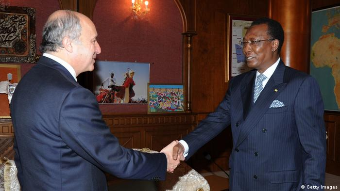 Chad president Idriss Deby Itno (R) shakes hands with French foreign Minister Laurent Fabius (L) STR/AFP/GettyImages)