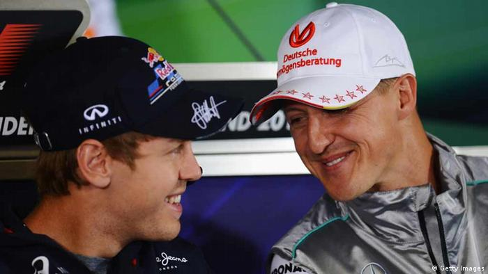 Sebastian Vettel dan Michael Schumacher pada Grand Prix Jerman 2012 (Getty Images)