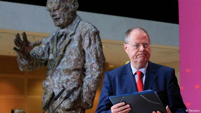 Peer Steinbrueck of the German Social Democratic party SPD leaves after a statement to the media in Berlin October 30, 2012. The centre-left challenger to German Chancellor Angela Merkel in next year's elections and former finance minister Steinbrueck, fended off criticism of his lucrative earnings from speeches, books and company boards. REUTERS/Tobias Schwarz (GERMANY - Tags: POLITICS)