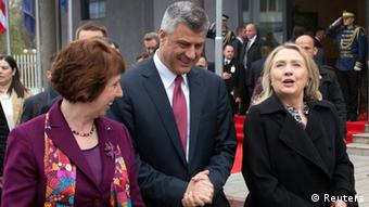 Kosovo's Prime Minister Hashim Thaci walks alongside U.S. Secretary of State Hillary Clinton (R) and EU Foreign Policy Chief Catherine Ashton (L) prior to a meeting at the Prime Minister's Office in Pristina October 31, 2012. Clinton's three-nation Balkan trip, probably her last before stepping down early next year, represents her final effort to settle some of the legacies of the bloody break-up of federal Yugoslavia in the 1990s, when her husband Bill Clinton was president. REUTERS/Saul Loeb/Pool (KOSOVO - Tags: POLITICS)
