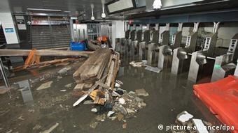 A handout photo dated 30 October 2012 and made available 31 October 2012 by Metropolitan Transportation Authority MTA, showing debris lying around at the South Ferry subway station after it was flooded by seawater during Hurricane Sandy, New York, USA. The US East Coast was to start picking up the pieces 31 October 2012 after superstorm Sandy left at least 33 people dead and damage estimated in the billions of dollars. New York Mayor Michael Bloomberg said the largest US city was going back to business and bus routes would be fully reopened Wednesday. The subway would probably take another four or five days to resume operations, he said late Tuesday. Some flights were to also resume. President Barack Obama planned to visit New Jersey Wednesday with the state's governor, Chris Christie, for a first-hand impression of the damage. EPA/PATRICK CASHIN / HANDOUT MANDATORY CREDIT: MTA, HANDOUT EDITORIAL USE ONLY