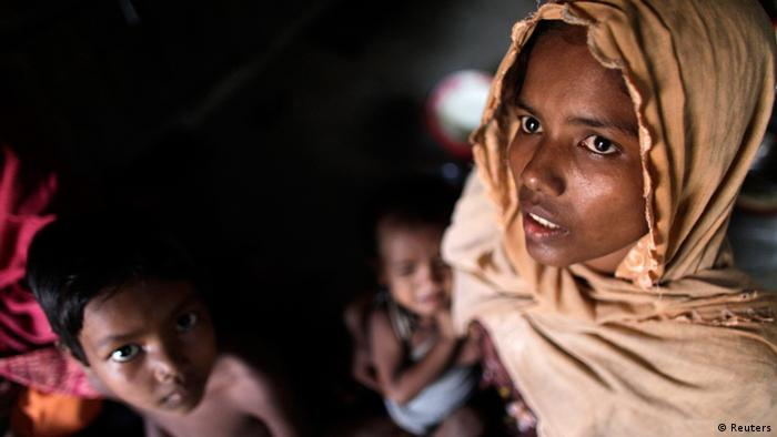 Shafika Begum, 22, and her children sit in a house as they hide with other relatives in Teknaf. Shafika, who belongs to a group of Rohingya Muslims currently hiding with local villagers to avoid being arrested by border guards of Bangladesh (Photo: REUTERS/Andrew Biraj)