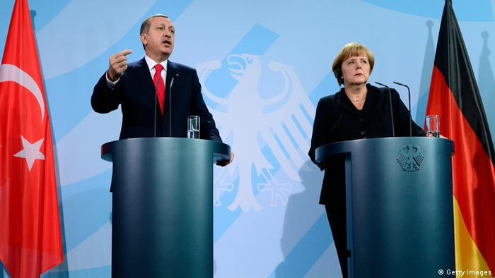 German Chancellor Angela Merkel and Turkish Prime Minister Recep Tayyip Erdogan (L) address a press conference after meeting for talks at the chancellery in Berlin on October 31, 2012. The talks were expected to focus on the crisis in Syria. AFP PHOTO / JOHN MACDOUGALL (Photo credit should read JOHN MACDOUGALL/AFP/Getty Images)