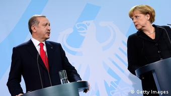 German Chancellor Angela Merkel and Turkish Prime Minister Recep Tayyip Erdogan (L) address a press conference after meeting for talks at the chancellery in Berlin on October 31, 2012. (JOHN MACDOUGALL/AFP/Getty Images)