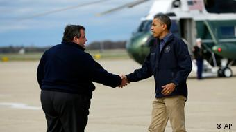 President Barack Obama is greeted by New Jersey Governor Chris Christie upon his arrival at Atlantic City International Airport (Photo: Pablo Martinez Monsivais/AP/dapd)