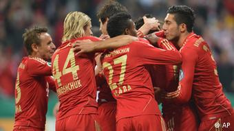 Bayern's players celebrate after scoring during the German Soccer Cup match (DFB Pokal) between FC Bayern Munich and 1. FC Kaiserslautern in Munich,Germany Wednesday, Oct. 31, 2012. (Foto:Kerstin Joensson/AP/dapd)