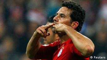 Source News Feed: EMEA Picture Service ,Germany Picture Service Bayern Munich's Claudio Pizarro celebrates a goal during the German DFB Cup (DFB Pokal) second round soccer match against 1. FC Kaiserslautern in Munich October 31, 2012. REUTERS/Michaela Rehle (GERMANY - Tags: SPORT SOCCER) DFB RULES PROHIBIT USE IN MMS SERVICES VIA HANDHELD DEVICES UNTIL TWO HOURS AFTER A MATCH AND ANY USAGE ON INTERNET OR ONLINE MEDIA SIMULATING VIDEO FOOTAGE DURING THE MATCH