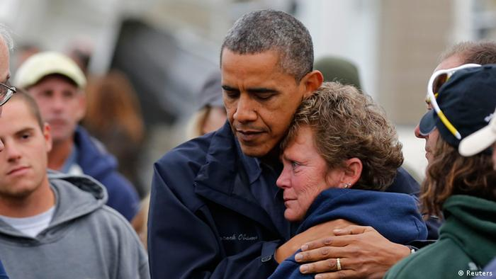U.S. President Barack Obama hugs North Point Marina owner Donna Vanzant as he tours damage done by Hurricane Sandy in Brigantine, New Jersey, October 31, 2012. Putting aside partisan differences, Obama and Republican Governor Chris Christie toured storm-stricken parts of New Jersey together on Wednesday, taking in scenes of flooded roads and burning homes in the aftermath of superstorm Sandy.