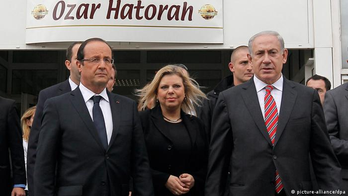 epa03454626 French President Francois Hollande (L) Israeli Prime Minister Benjamin Netanyahu (R) and his wife Sarah Netanyahu (C) leave a classroom during a vist to the 'Ozar Hatorah' Jewish school in Toulouse, France, 01 November 2012. French President Francois Hollande on 01 November declared the security of French Jews to be a 'national cause' and pledged 'unrelenting combat' against anti-Semitism, including on social networks. Hollande made the remarks in the presence of Israeli Prime Minister Benjamin Netanyahu, during a ceremony in the city of Toulouse to commemorate three Jewish children and a rabbi shot dead by an Islamist gunman in March. Netanyahu is on a two-day visit to France. EPA/GUILLAUME HORCAJUELO
