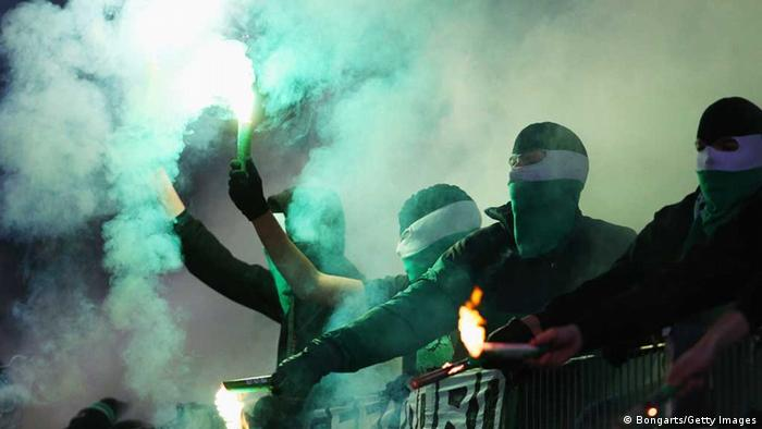 HANNOVER, GERMANY - OCTOBER 31: Fans of Hannover light flares prior to the second round DFB Cup match between Hannover 96 and Dynamo Dresden at AWD Arena on October 31, 2012 in Hannover, Germany. (Photo by Joern Pollex/Bongarts/Getty Images)