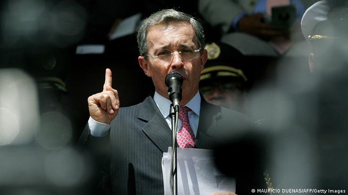 Colombian President Alvaro Uribe delivers a speech on the extradition of 13 members of the demobilized United Self-Defenses of Colombia (AUC) to the US on May 14, 2008, in Bogota during a military ceremony at General Santander Academy. Colombia on Tuesday extradited 14 of its nationals, including 13 paramilitary leaders, to the United States to face drug trafficking charges. AFP PHOTO/Mauricio DUE-AS (Photo credit should read MAURICIO DUENAS/AFP/Getty Images)
