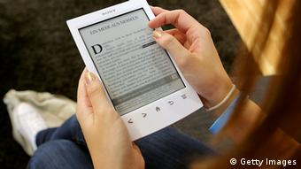FRANKFURT AM MAIN, GERMANY - OCTOBER 10: A young girl looks at a Sony e-book at the Frankfurt Book Fair on October 10, 2012 in Frankfurt, Germany. The Frankfurt Book Fair is the largest in the world and will run from October 10 - 14, 2012. (Photo by Hannelore Foerster/Getty Images)