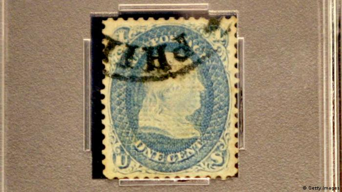 NEW YORK - NOVEMBER 02: A rare 1-cent Z-grill stamp depicting Benjamin Franklin that was issued in 1868 and named because of an experimental security grill, is displayed before a swap for a block of four rare United States airmail error stamps, known as the Inverted Jenny plate block, worth nearly $3 million November 2, 2005 in New York City. Stamp dealer Charles Shreve, who is standing in for stamp dealer Bill Gross, swapped the block of United States airmail error stamps for a rare 1-cent Z-grill stamp. With the completion of the trade, the block's owner, bond investor Bill Gross, will own what is believed to be the first complete collection of 19th-century United States stamps ever assembled. The 1-cent Z-grill stamp is a blue stamp depicting Benjamin Franklin that was issued in 1868 and named because of an experimental security grill. (Photo by Spencer Platt/Getty Images)