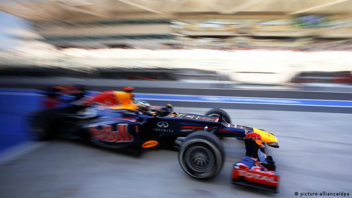 German Formula One driver Sebastian Vettel of Red Bull steers his car through the pit lane during the third practice session at the Yas Marina Circuit in Abu Dhabi (Photo; dpa)