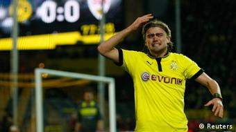 Borussia Dortmund's Marcel Schmelzer reacts with frustration