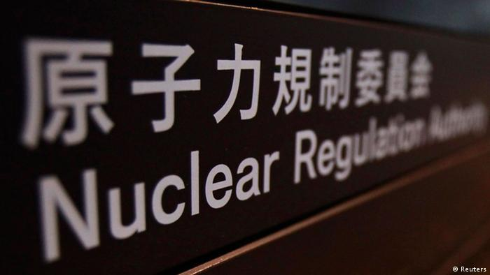 A sign is pictured at the lobby of the Nuclear Regulation Authority office building in Tokyo October 18, 2012. Japan's new nuclear regulator will impose tighter safety standards for atomic plants, taking account of geological data in the earthquake-prone country, its head said on Thursday. Shuichi Tanaka, in an interview, also said his new body would have the authority to restart reactors idled since last year's Fukushima disaster once new safety standards were in place and met. Restarting such units is a key point in reducing the import bill for fossil fuels to produce electricity. To match Interview JAPAN-NUCLEAR/ REUTERS/Yuriko Nakao (JAPAN - Tags: POLITICS ENERGY BUSINESS)