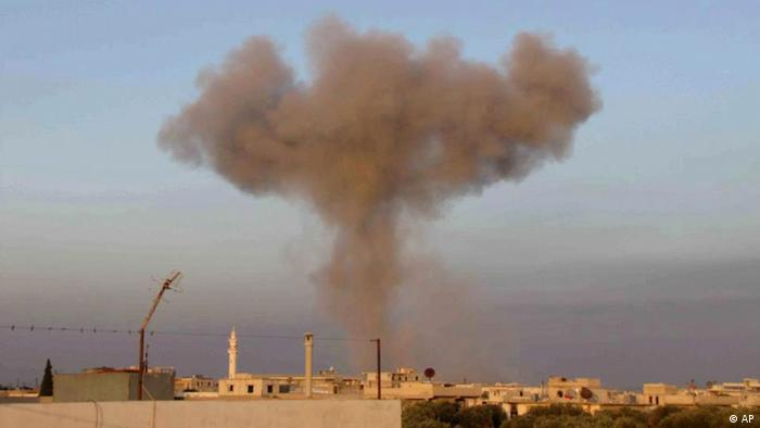 Citizen journalism image, provided by Edlib News Network, ENN, which has been authenticated based on its contents and other AP reporting, black smoke rise up from bombing by a Syrian forces warplane in Taftanaz village(Photo: Edlib News Network ENN/AP/dapd)