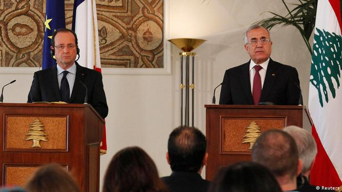 Lebanon's President Michel Suleiman (R) and France's President Francois Hollande in a joint news conference at the presidential palace in Baabda, near Beirut November 4, 2012.France will oppose those creating instability in Lebanon, Hollande said on Sunday, two weeks after a car bombing in Beirut that the political opposition have blamed on Syrian President Bashar al-Assad. REUTERS/Mohamed Azakir (LEBANON - Tags: POLITICS)