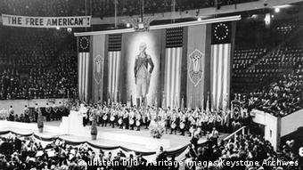 Rally of the pro-Nazi German American Bund, Madison Square Garden, New York, USA, 1939. The German American Bund was founded in the 1930s as an organisation sympathetic to the ideology and policies of Adolf Hitler's Nazi government in Germany. In 1936 a German-born naturalised citizen named Fritz Kuhn became the movement's official leader. It reached the zenith of its popularity in 1939, when 20,000 people attended its rally in New York. Kuhn was arrested, however, when evidence came to light that he had embezzled money from the Bund's funds, and the loss of the movement's leader and the beginning of World War II saw its support dissipate.