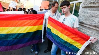 Gay rights activists in south Africs with rainbow banners. EPA/NIC BOTHMA
