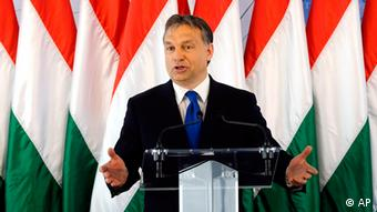 Orban speaking in front of a row of Hungarian flags Photo:MTI, Zsolt Czegledi/AP/dapd
