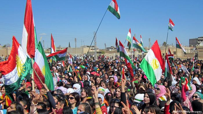 Syrian Kurds wave the Kurdish flag as they rally against the Syrian regime and to mark Noruz spring festivities in the northern city of Qamishli on March 21, 2012. Noruz marks the spring equinox of the solar year 1390. The United Nation's general assembly in 2010 recognized the International Day of Noruz, describing it as a festival of Persian origin which has been celebrated for over 3000 years. AFP PHOTO/STR (Photo credit should read -/AFP/GettyImages)