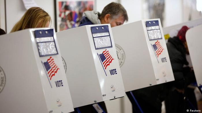 People vote in the U.S. presidential election at a polling station set up for those affected by Hurricane Sandy, in an art gallery at John Jay College, in New York November 6, 2012. REUTERS/Chip East (UNITED STATES - Tags: POLITICS USA PRESIDENTIAL ELECTION ELECTIONS)