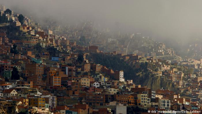 An aerial view of La Paz shows countless small homes blanketed in smog