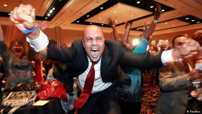 Ajay Narayan cheers as the race is called for U.S. President Barack Obama by a television network during the Nevada State Democrats' election night party at the Mandalay Bay Resort in Las Vegas, Nevada November 6, 2012. REUTERS/Las Vegas Sun/Sam Morris (UNITED STATES - Tags: POLITICS ELECTIONS TPX IMAGES OF THE DAY USA PRESIDENTIAL ELECTION)