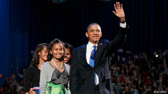 U.S. President Barack Obama and his family walk onstage during his election night victory rally in Chicago, November 6, 2012. (L-R) Daughters Malia, Sasha, First lady Michelle Obama and the President. REUTERS/Jason Reed (UNITED STATES - Tags: POLITICS ELECTIONS USA PRESIDENTIAL ELECTION)