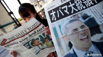 A woman reads an extra edition of a newspaper reporting U.S. President Barack Obama's re-election (Photo: Reuters)