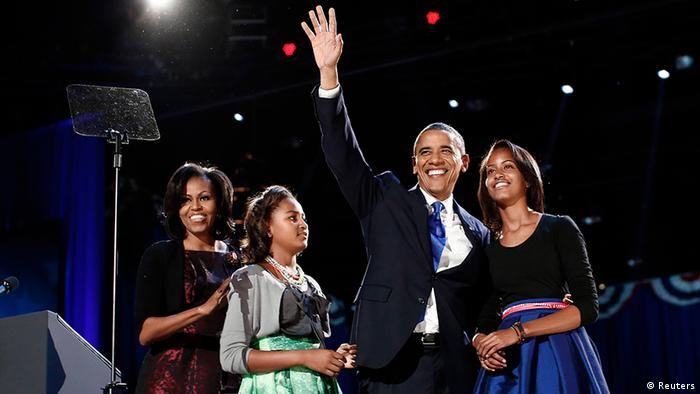 U.S. President Barack Obama gathers with his wife Michelle Obama (L) and daughters Sasha and Malia (R) during his election night victory rally in Chicago November 7, 2012. REUTERS/Jason Reed (UNITED STATES - Tags: POLITICS USA PRESIDENTIAL ELECTION ELECTIONS)