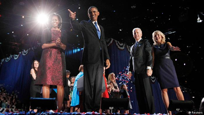 The Obamas and Bidens celebrating the victory (Reuters)