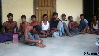 People who have been rescued after a boat sank in Bay of Bengal sit in the office of Bangladesh Coast Guard in Teknaf November 7, 2012. (Photo: REUTERS/Stringer)