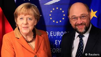 Germany's Chancellor Angela Merkel (L) is welcomed by European Parliament President Martin Schulz in Brussels (Photo: REUTERS/Yves Herman)
