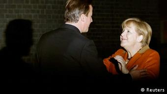 Britain's Prime Minister David Cameron greets Germany's Chancellor Angela Merkel (R) at Downing Street in central London on November 7, 2012. (Photo: Olivia Harris/REUTERS)