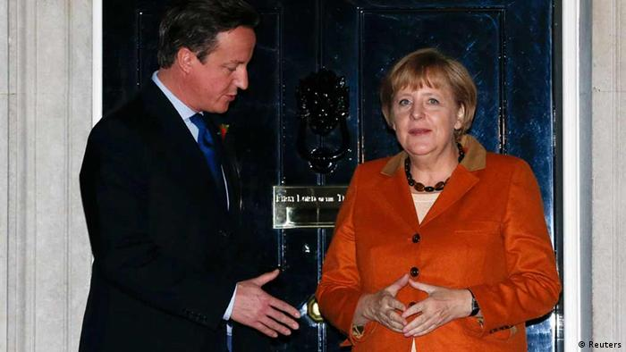Britain's Prime Minister David Cameron greets German Chancellor Angela Merkel (R) at Downing St in central London on November 7, 2012. Merkel on Wednesday warned Britain not to turn its back on Europe ahead of talks in London with Prime Minister David Cameron aimed at overcoming divisions that threaten to block a European Union budget deal later this month. REUTERS/Olivia Harris (BRITAIN - Tags: POLITICS)