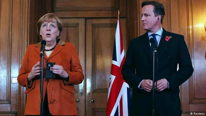 Britain's Prime Minister David Cameron speaks to the media with Germany's Chancellor Angela Merkel at Downing Street in central London November 7, 2012. Photo: REUTERS/POOL/Dan Kitwood