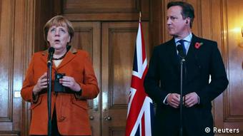 Britain's Prime Minister David Cameron speaks to the media with Germany's Chancellor Angela Merkel (L) at Downing Street in central London November 7, 2012. Merkel on Wednesday warned Britain not to turn its back on Europe ahead of talks in London with Prime Minister David Cameron aimed at overcoming divisions that threaten to block a European Union budget deal later this month. REUTERS/POOL/Dan Kitwood (BRITAIN - Tags: POLITICS)