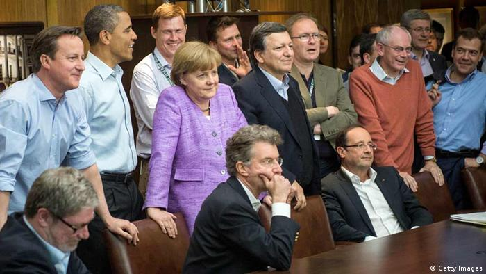 CAMP DAVID, MD - MAY 19: British Prime Minister David Cameron, U.S. President Barack Obama, German Chancellor Angela Merkel, EU Commission President Jose Manuel Barroso, President of the European Council Herman Van Rompuy and Russian Prime Minister Dmitry Medvedev watch the UEFA Champions League Final between FC Bayern Muenchen and Chelsea FC during the 2012 G8 Summit at Camp David on May 19, 2012 in Camp David, Maryland. Leaders of eight of the worlds largest economies are meeting over the weekend in an effort to keep the lingering European debt crisis from spinning out of control. (Photo by Guido Bergmann-Pool/Getty Images)